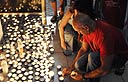 Lighting candles in memory of fallen sons (Photo: George Ginsberg)