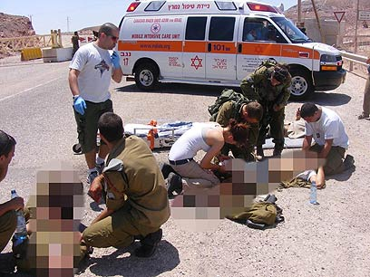 Victims of attack treated on scene Thursday (Photo: Yossi Ben)