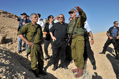 From left: Maj.-Gen. Rousso, Defense Minister Barak and Chief of Staff Gantz at scene of attack (Photo: Defense Ministry)