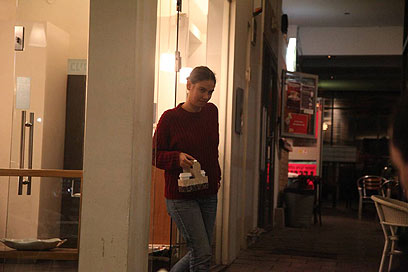 Kamm buying coffee moments before going to jail (Photo: Motti Kimchi)