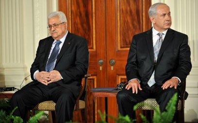Prime Minister Benjamin Netanyahu and Palestinian President Mahmoud Abbas. 'Both sides are failing to internalize the ramifications of the bi-national state option' (Photo: AFP)