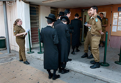 Haredi men at IDF recruitment center issuing enlistment exempt (Photo: Yaron Brenner)