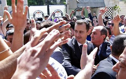 Assad at Damascus university (Photo: AP)