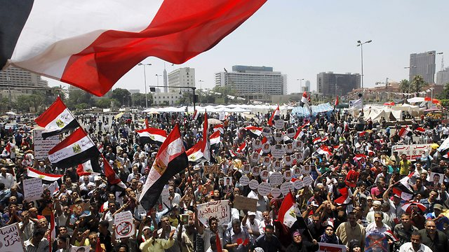 Protesters in Cairo's Tahrir Square. Many women were publicly raped (Photo: AP) (Photo: AP)