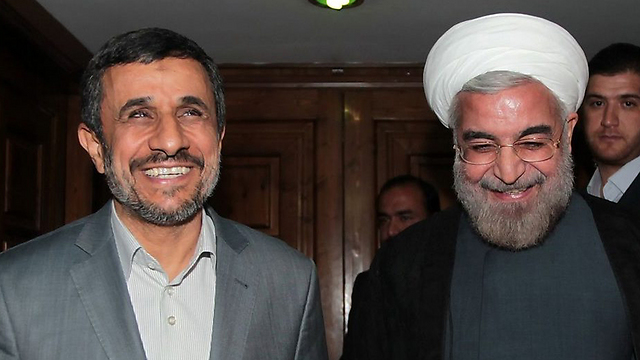 Ahmadinejad with current president and possible future rival, Hassan Rouhani (Photo: AFP)