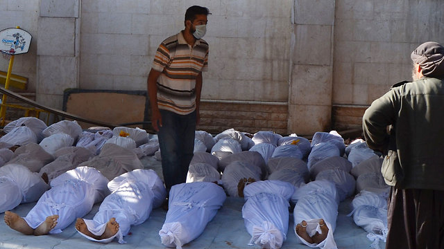 Counting bodies (Photo: Reuters)