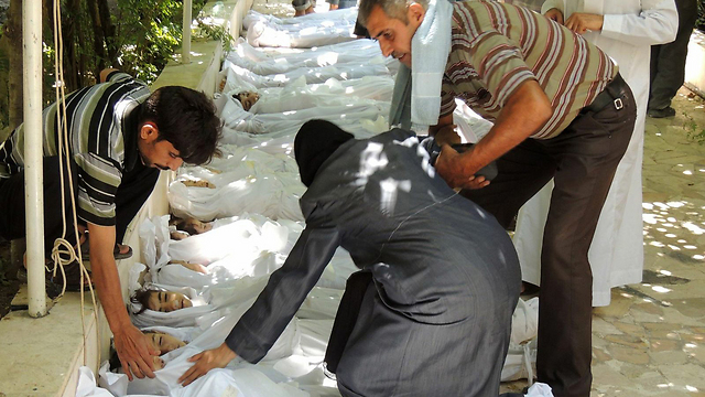 Children's bodies near Damascus (Photo: AFP PHOTO / HO / SHAAM NEWS NETWORK)