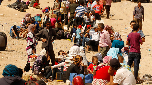 Syrian refugees who crossed border to Iraq (Photo: Reuters)