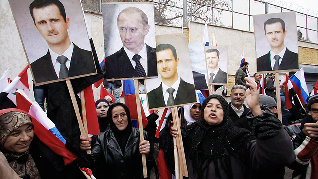 Assad, Putin support rally in Damascus (Photo: AP)