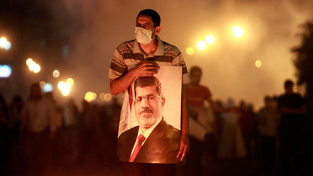 A Morsi supporter at a demonstration in Egypt (Photo: Reuters) (Photo: Reuters)