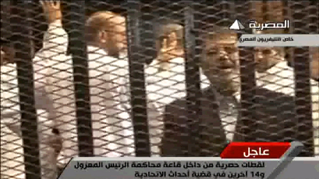 Morsi on trial (Screen capture from Egyptian television)