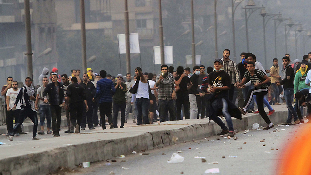 Muslim Brotherhood supporters throwing stones at police during a protest in Cairo, November 2013.  (Photo: AP)