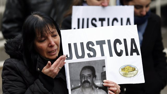 Family of victims demand justice in a rally marking 19 years to the attack (Photo: Reuters)