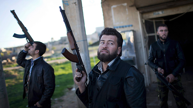 Free Syrian Army fighters. Recovering (Photo: AP)