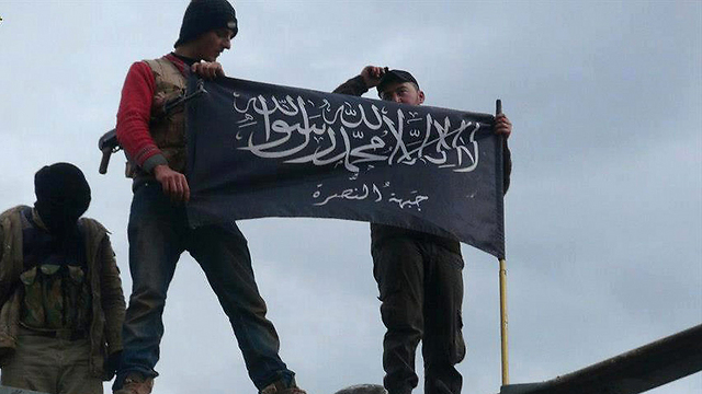 Jabhat al-Nusra members enforcing the sharia law in the area under their control (Photo: AP) (Photo: AP)