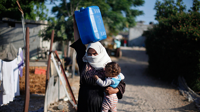 Carrying water jerrycan  (Photo: Reuters)
