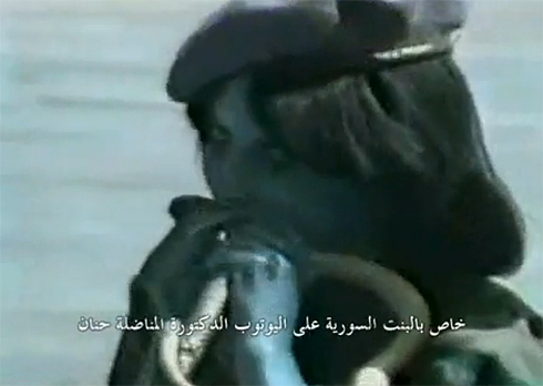 Ridiculous show of courage. Syrian soldier biting a snake during the Hafez Assad era