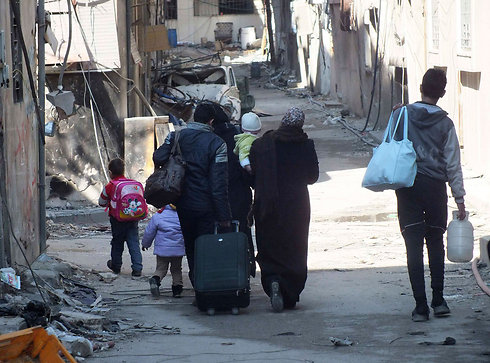 Citizens evacuated from Homs (Photo: Reuters) (Photo: Reuters)