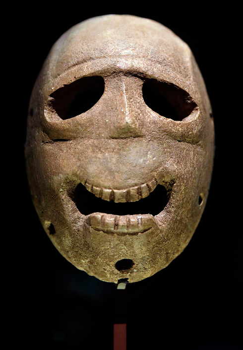 The stone masks are thought to have been made to look like the skulls of dead ancestors, used in civilization's first public ceremonies (Photo: AP) (Photo: AP)