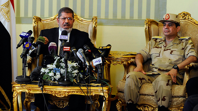 Morsi as president with Sisi at his side - May 2013 (Photo: Reuters)