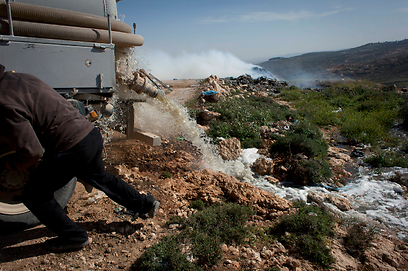 Sewage being spilled in a West Bank valley (Photo: AP)