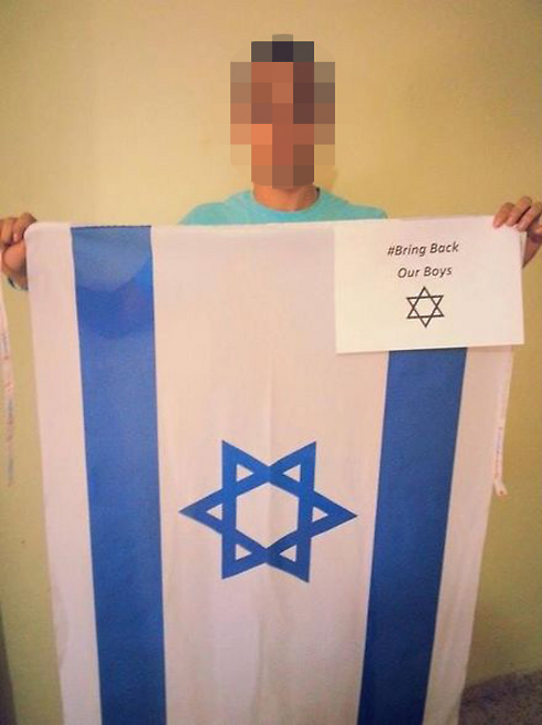 """Arab youth posts picture of himself holding an Israeli flag with the words """"Bring Back Out Boys"""""""