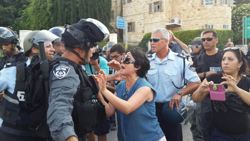 MK Zoabi faces off against riot police at a protest in Haifa. (Photo: Muhammed Shenawi) (Photo: Muhammed Shenawi)