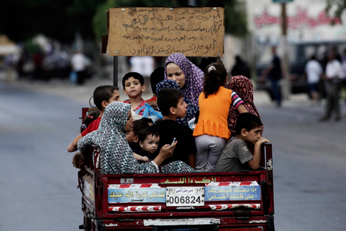 Palestinians fleeing the fighting in Gaza (Photo: AP)  (Photo: AP)