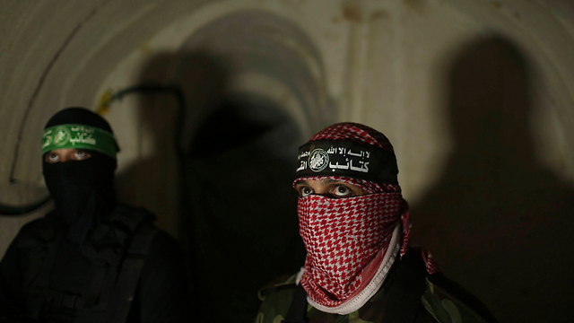Hamas militants in a tunnel (Photo: Reuters) (Photo: Reuters)