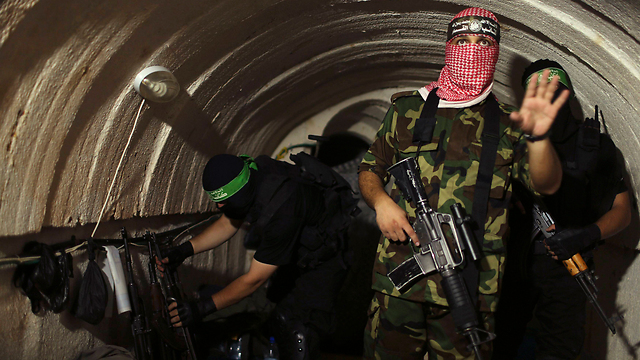Izz ad-Din al-Qassam Brigade fighters in one of Hamas's tunnels (Photo: Reuters) (Photo: Reuters)