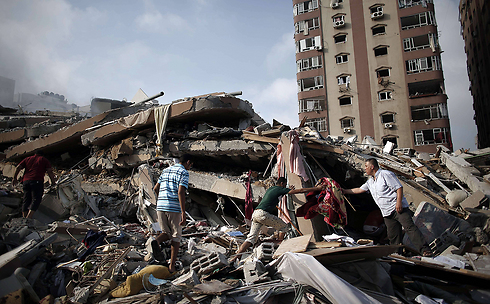 Wreckage of home bombed by the IAF during Gaza war (Photo: AFP)