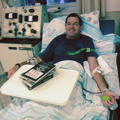 Shahar's father Shimon donating blood for his son.