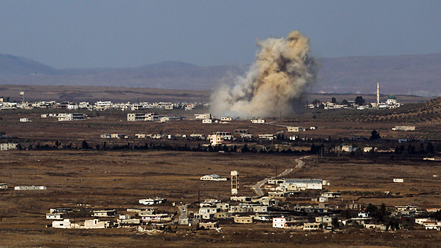 Smoke rises from Quneitra as rebels clash with Assad's forces (Photo: EPA) (Photo: EPA)