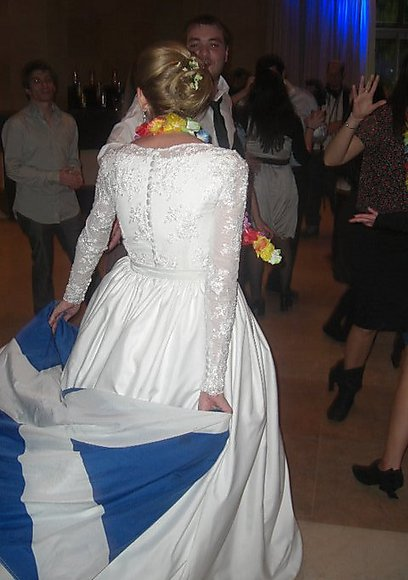 Weddings with a skullcap and a kilt are a common sight among Scotland's Jewish community. A Jewish bride holds Scotland's flag (Photo: Alan Hayman)