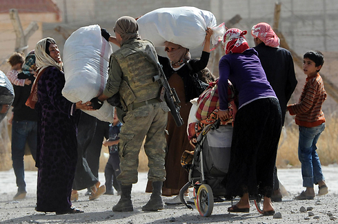 Kurdish refugees in the Turkish-Syrian border (Photo: Gettyimages)