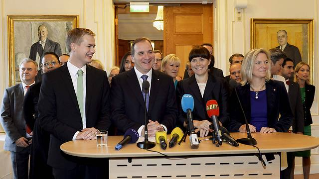 Flanked by his government, Swedish PM Stefan Lofven (2nd left) speaks at a press conference in Stockholm on Friday. (Photo: AP) (Photo: AP)