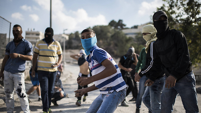Stone-throwers in East Jerusalem: 'Israel is giving terrorism a reason to grow' (Photo: Getty Images) (Photo: Getty Images)
