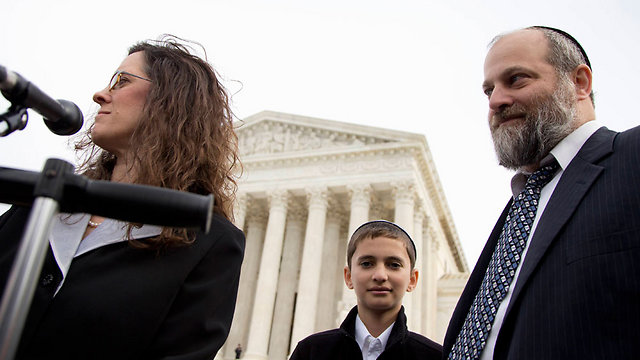 Menachem Zivotofsky and his father at the Supreme Court in Washington DC. (Photo:AP)