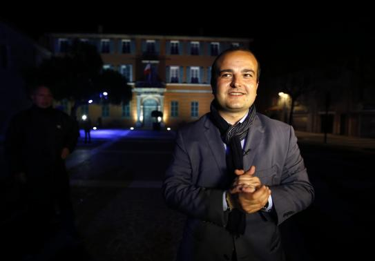 Mayoral candidate David Rachline of France's far-right National Front political party poses in front of the town hall (Photo: Reuters) (Photo: Reuters)