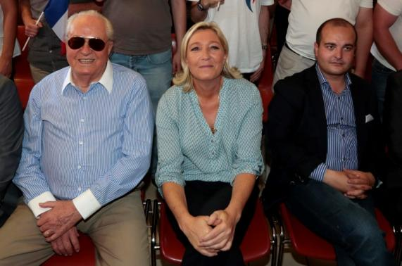 Marine Le Pen, France's National Front political party leader (C), with her father Jean Marie Le Pen (L) and Frejus Mayor David Rachline (Photo: Reuters) (Photo: Reuters)