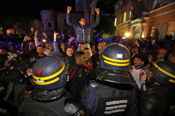 Demonstrators face riot policemen in front of campaign headquarters of mayoral candidate David Rachline after he won elections (Photo: Reuters) (Photo: Reuters)
