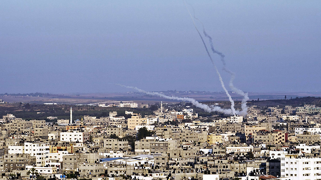 Palestinians fire rockets at Israel from Gaza during last summer's conflict. (Photo: AFP) (Photo: AFP)