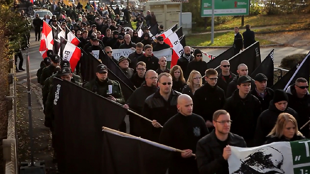 With flags and wreaths, neo Nazis commemorate a so called 'National Heroes' Remembrance Day.'