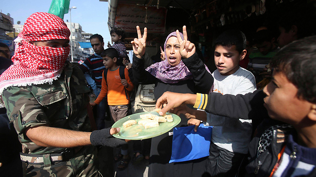 Sweets handed out in Gaza to celebrate the attack (Photo: Reuters)