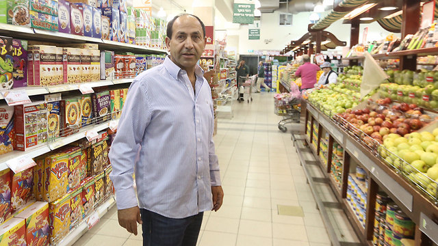 Owner Rami Levy in the supermarket. (Photo: Gil Yohanan)