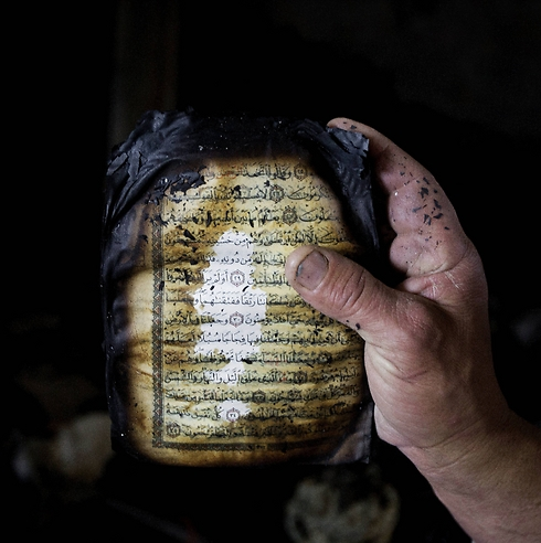 A koran that was burned during the fire in a mosque in the West Bank in November. (Photo: Associated Press) (Photo: Associated Press)