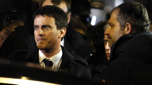 French PM Manuel Valls visits the Hyper Cacher kosher supermarket in Paris, where four Jews were gunned down in an attack last month. (Photo: AFP) (Photo: AFP)