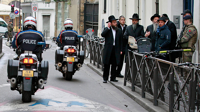 Security at Paris' Jewish Quarter. 'One thread connects three events separated by decades: Our Jewishness, our Israeliness, and of course the hatred which knows no bounds' (Photo: AP)