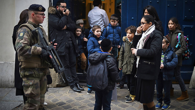 A soldier patrols by a Jewish school in Paris (Photo: GettyImages) (Photo: Getty Images)