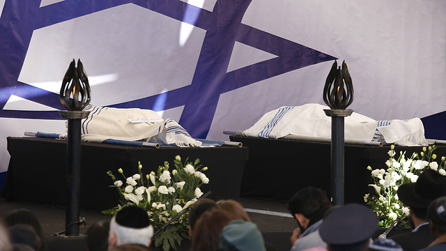 The bodies of the four victims wrapped in prayer shawls ahead of their burial. (Photo: AFP)